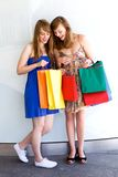 Women looking at shopping bags stock images