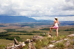Women looking at tepui in Venezuela. Women tourist looking at table-top mountains called Tepui in background, Gran Sabana, Guayana Highlands, Venezuela, South Stock Photos