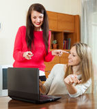 Women looking to laptop at table Royalty Free Stock Photography