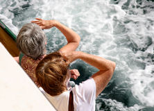 Women looking to sea. Women on a cruise ship looking to sea Royalty Free Stock Photos