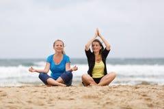 Women in lotus pose Royalty Free Stock Images