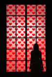 Women in love looking through window with heart signs Royalty Free Stock Image