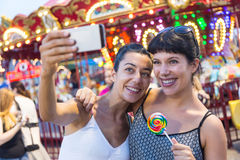 Women at Luna Park. Happy Young Women Taking Selfie at Luna Park Royalty Free Stock Photos