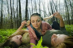 Women lying. Young women lying in the forest Royalty Free Stock Image