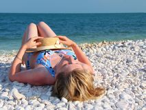 Women lying on the beach royalty free stock photography