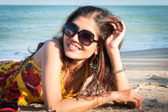 Women lying on the beach. Beautiful woman lying on the beach Stock Photography