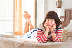 Women lying on bed with smile face Royalty Free Stock Images