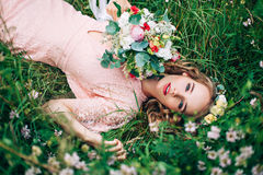 Women Lying On Green Meadow Royalty Free Stock Photo