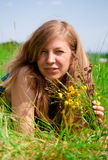 Women lying in meadow Royalty Free Stock Images