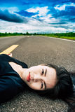 Women lying on the street. And look at camera Stock Photo