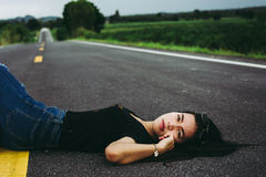 Women lying on the street. And looking to sky Royalty Free Stock Photo
