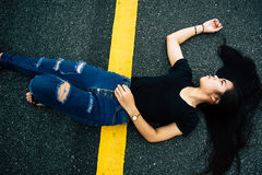 Women lying on the street. Top view of a woman lying on the street Royalty Free Stock Photography