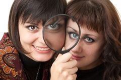 Women with magnifying glass Royalty Free Stock Images