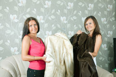 Women  make boast of fur coats Stock Photos