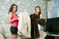 Women  make boast of fur coats. In home Royalty Free Stock Images