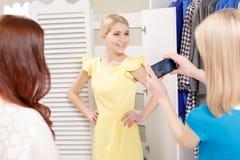 Women make photos in a shop Stock Image