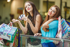 Women make purchases with credit cards at the mall Royalty Free Stock Images