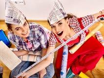 Women make repairs in apartment royalty free stock image