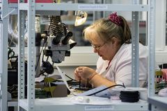 Free Women Make Soldering Of Radio Components To Electronic Boards. Plant For The Production Of Electronic Equipment. Stock Images - 109716094