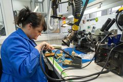 Free Women Make Soldering Of Radio Components To Electronic Boards. Plant For The Production Of Electronic Equipment. Stock Photography - 114056262