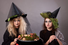 Women make up as witches for Halloween. In the studio Stock Images