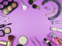 Women makeup materials created with concept and purple. Background Stock Photos