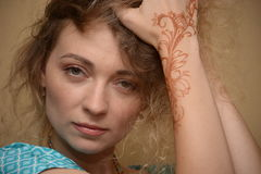 Women with makeup and mehendy. Face of woman with makeup and hand with mehendy Stock Image