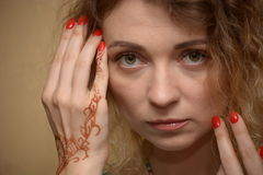Women with makeup and mehendy. Face of woman with makeup and hand with mehendy Royalty Free Stock Images