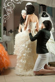 Women making adjustment to wedding gown Royalty Free Stock Image