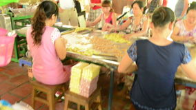 Women making coconut candy stock video