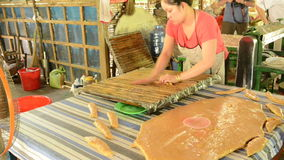 Women making coconut candy stock footage