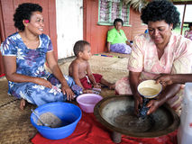 Women making kava