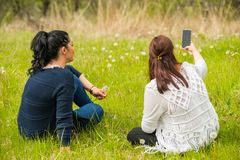 Women making photos with phone Royalty Free Stock Photography