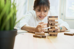 Women making a pyramid with empty wooden cubes. Business concept with step-by-step for a firm basis. Women making a pyramid with empty wooden cubes. Business Stock Image