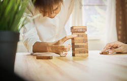 Women making a pyramid with empty wooden cubes. Business concept with step-by-step for a firm basis. Vintage style.  Stock Photos
