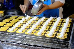 Women are making Thai Crispy Pancake. stock images