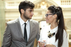 Women and man flirting. Beautiful women and attractive man flirting royalty free stock photos