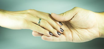 Women and man hand. Woman hand is with wedding ring Royalty Free Stock Photo