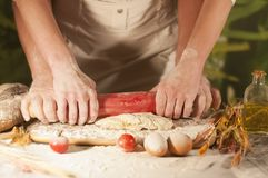 Women and men baker hands  pasta butter cook tomato preparation dough and making bread Royalty Free Stock Photo