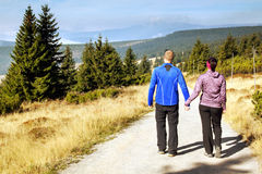 Women and man looks out over the mountains, Krkonose Stock Images