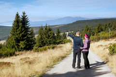 Women and man looks out over the mountains, Krkonose Stock Photography