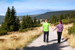 Women and man looks out over the mountains, Krkonose Royalty Free Stock Image