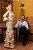 Women and man in traditional flamenco dresses dance during the Feria de Abril on April Spain Royalty Free Stock Images