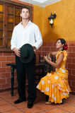 Women and man in traditional flamenco dresses dance during the Feria de Abril on April Spain Royalty Free Stock Photos