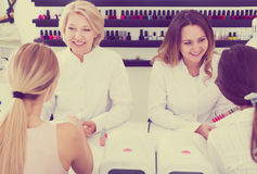 Women manicurists manicuring female clients royalty free stock photos
