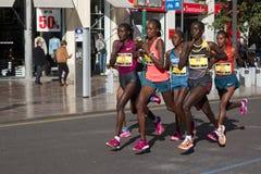 Women Marathon Runners. VALENCIA, SPAIN - NOVEMBER 16, 2014: The lead women runners of the 2014 Valencia Marathon.  Beata Naigambo, of Namibia, won the women Royalty Free Stock Photography