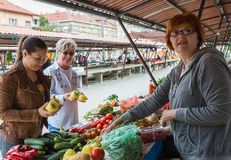 Women at market place Stock Images