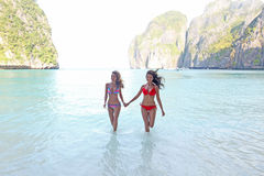 Women in Maya bay. Beautiful women in bikini enjoy sea at Maya bay, Thailand Royalty Free Stock Photo