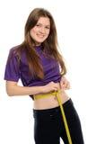 Women measures a waist. Separately on a white background Stock Photos