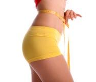 Women measures a waist Royalty Free Stock Photo